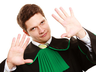 Law. Man lawyer in polish gown showing stop hand sign