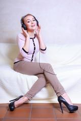 Modern woman with headphones listening music
