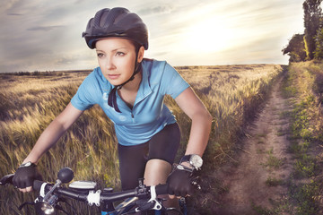 Female rider cycling on a rural road