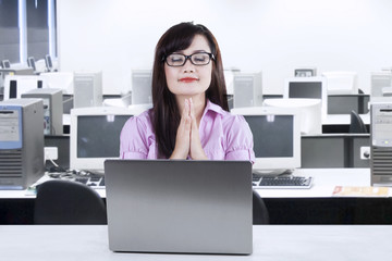 Businesswoman praying while working 3