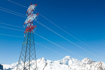 High voltage power lines in winter mountain landscape