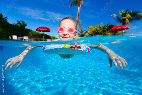 canvas print picture Little girl at swimming pool