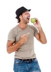 Smiling man eating a green apple