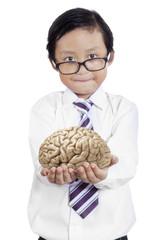Little businessman holds brain 1