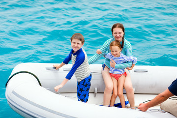 Family in inflatable dinghy boat