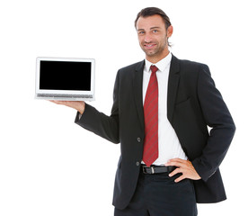 Handsome young business man working on his laptop