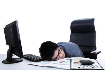 Tired businessman sleeping at workplace