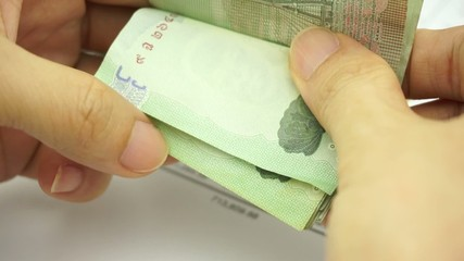 Man counting bills on finance account
