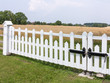Farmland with white fence