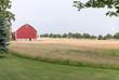 Farmland with red barn