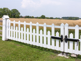 Farmland with white fence