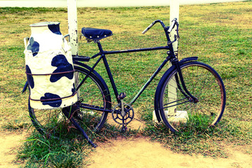 bicycle with steel milk container at the back
