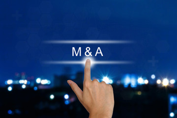 hand pushing M&A or Merger and Acquisition button on touch scree