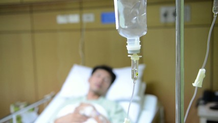 intravenous drip man, face out of focus