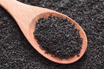 Black tea on a wooden spoon