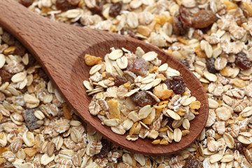 Muesli in a wooden spoon