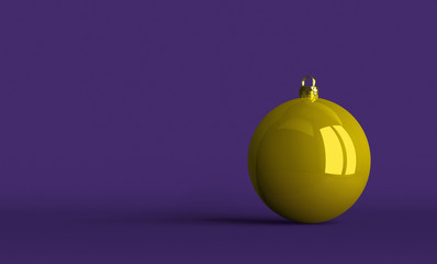 Yellow Christmas ball on violet background