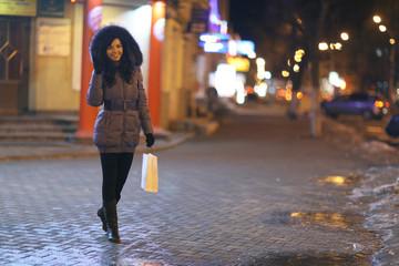 girl winter night in the city - walk