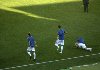 Soccer players running and warming up before a football game