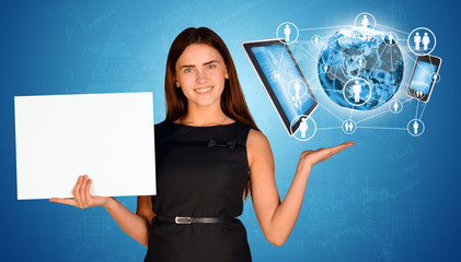 Businesswoman holding empty paper and Earth with electronics