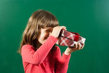 Little girl opening gift box