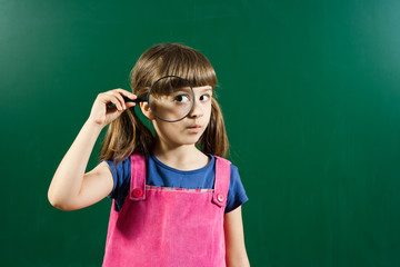 Schoolgirl with magnifying glass