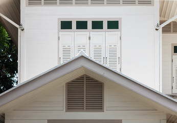 White wooden window and gable of vintage house