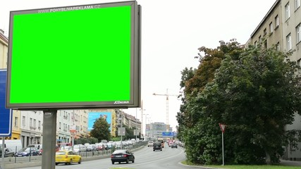 billboard - green screen - urban street with passing cars