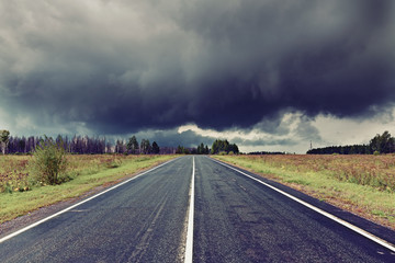 road and dark thunder clouds