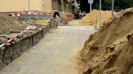 repair the urban street - grit, bricks - pavement