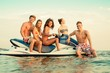 Group of multi ethnic friends sitting on a jet ski