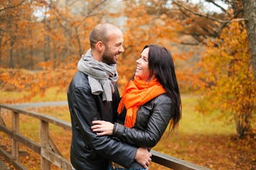 Happy middle-aged couple outdoors on beautiful autumn day