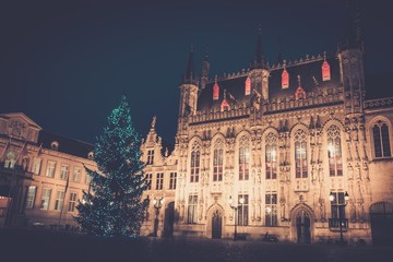 Illuminated Christmas tree on a Burg square in Bruges, Belgium