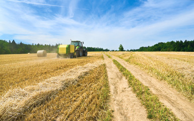 Handling of straw by baler in a field