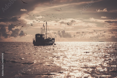 Fisherman's boat in a sea © Nejron Photo