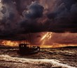 Fishing boat in a stormy sea - 69189283