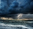 Heavy rain over stormy ocean