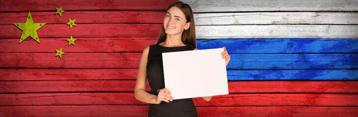 Businesswoman holding paper sheet