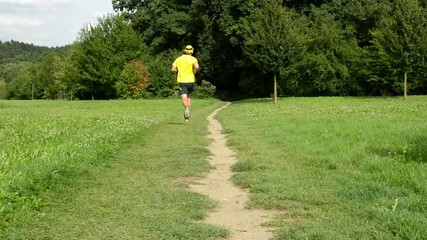 man sports - running - park (trees and grass)