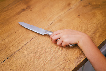 Child is trying to get a kitchen knife.