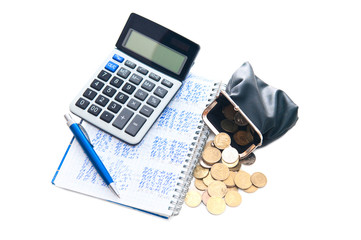 Business concept. Calculator, notebook,purse, pen and coins on w
