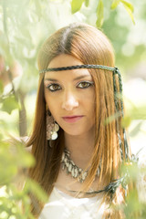 Closeup portrait of beautiful hippie young woman, outdoor.