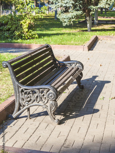 Old bench in city public park