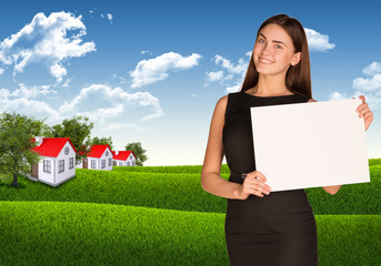 Businesswoman with landscape and houses