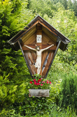 Wooden crucifix on the background green forests