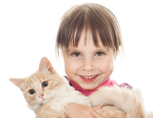 Happy little girl with a red kitten.