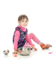 Girl playing in cooking