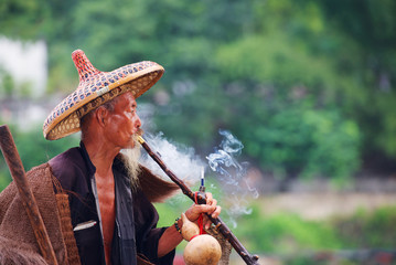 Chinese old fisherman smoking