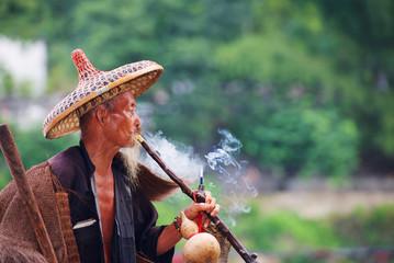 Chinese old fisherman smoking