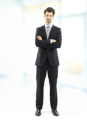 Executive businessman standing at office